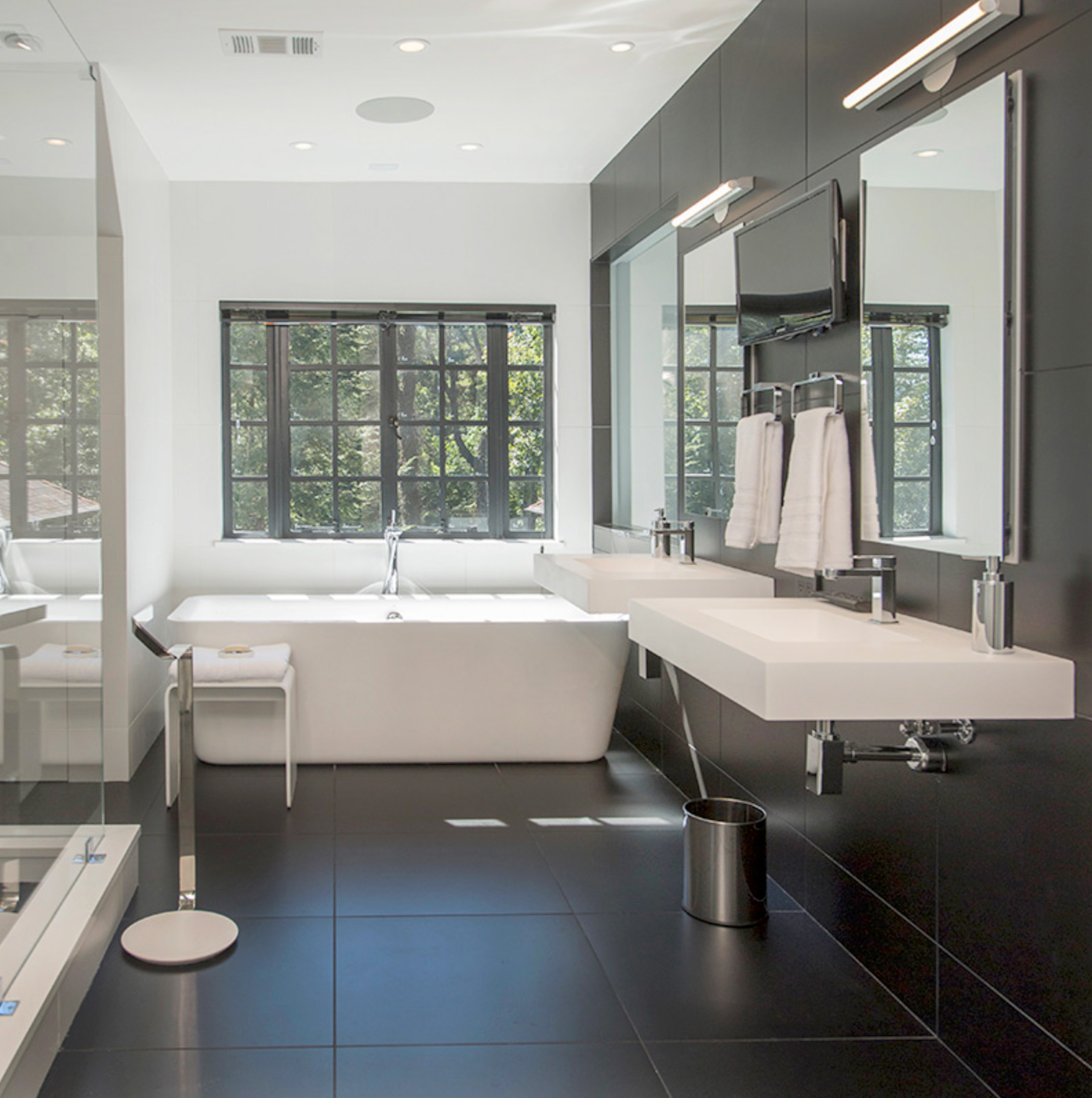 a stunning black and white bathroom