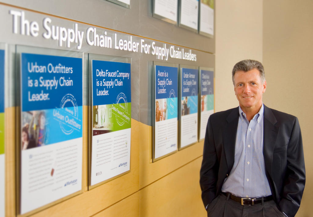 a CEO standing by a display in his office