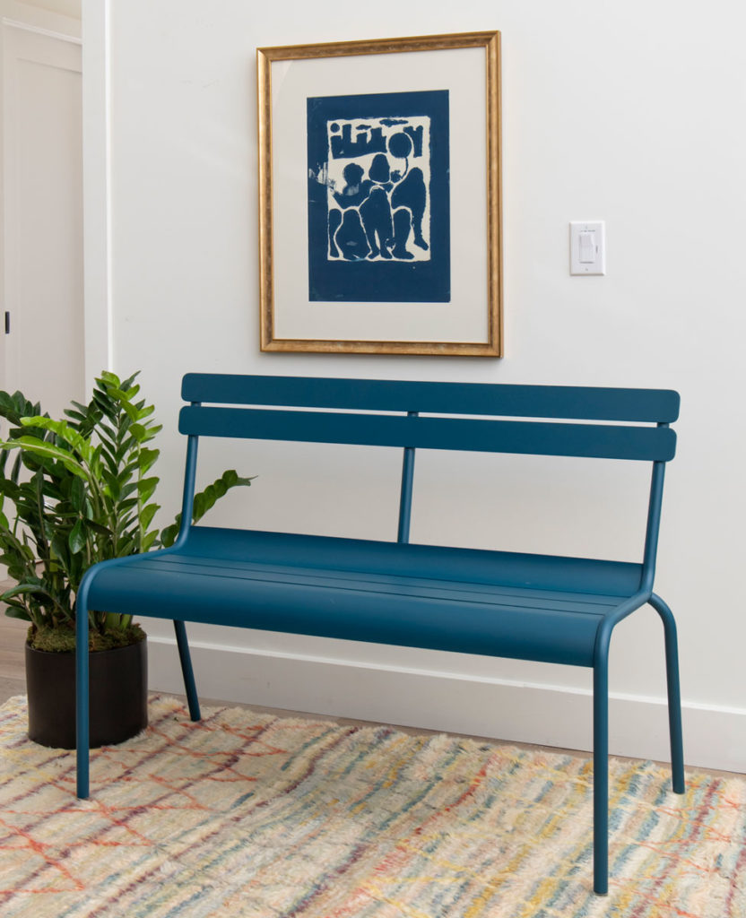 a modern bench sitting in a hallway