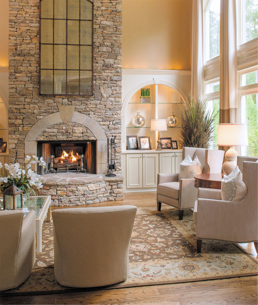 a great room with fireplace full of comfortable furniture