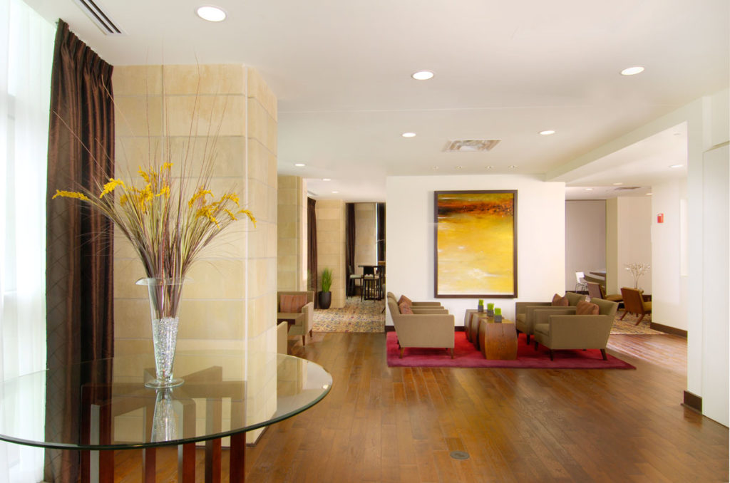the interior lobby of an upscale apartment complex