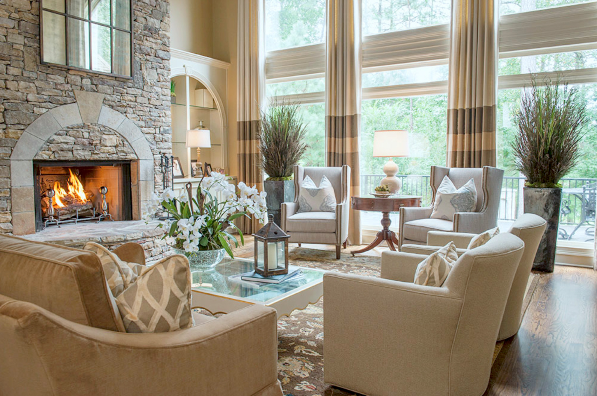 a roaring fireplace with comfortable chairs