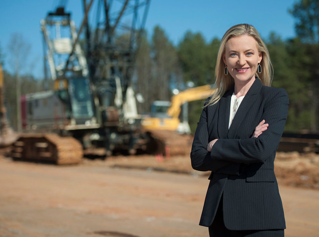 an exec in front of her company's construction site