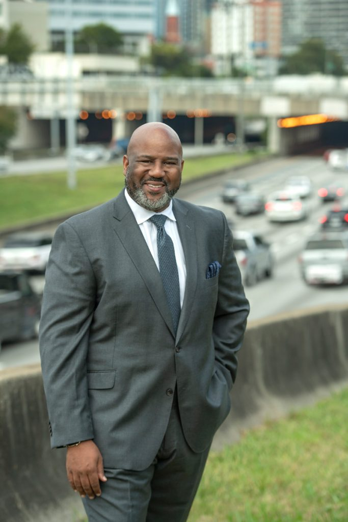 a highway CEO in front of the downtown connector