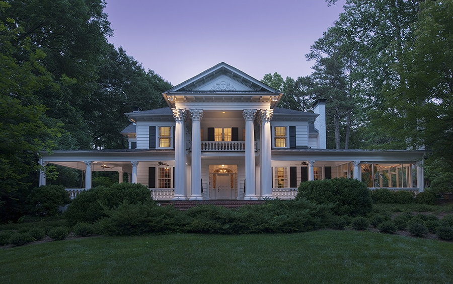 an impressive southern mansion at sunset