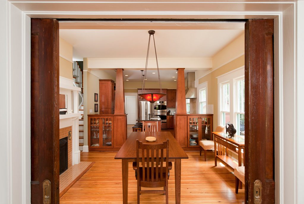 pocket doors reveal a renovated bungalow dining room