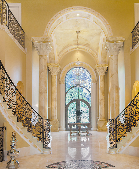 an impressive foyer with dual winding staircases